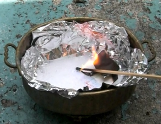 flower burning in improvised cauldron